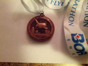 Medal back.  Gotta love that you see the backside of the pig.